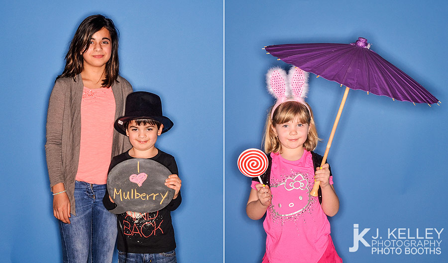 Blue Background, umbrella and chalk board photo booth props in an open air photo booth