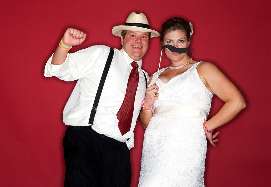 Piper and Justin using the photo booth at their wedding reception in Columbia Mo