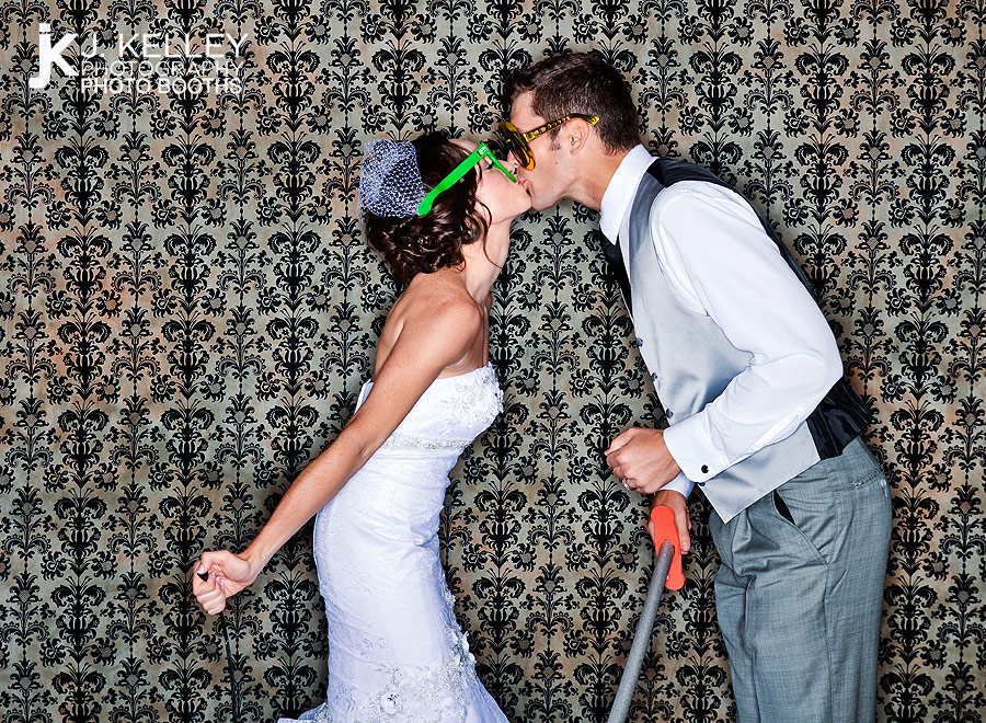 Bride and groom kissing in the photo booth at their wedding reception in St. Louis Missouri