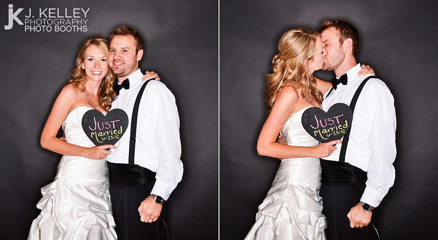 A Bride And Groom Take Their Photograph In Photo Booth At Wedding Reception