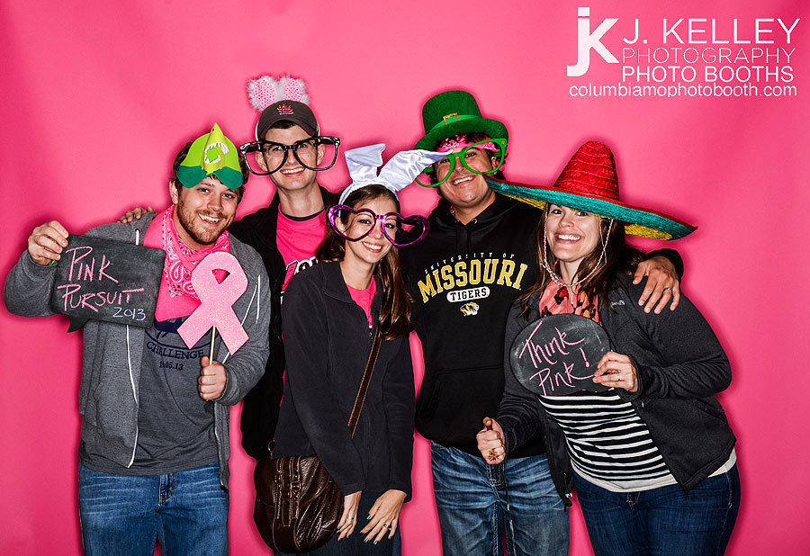Photo booth in Columbia Missouri for breast cancer fundraiser with pink background