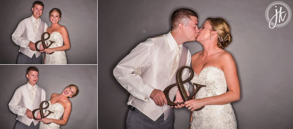 Jefferson City Wedding Reception Photo Booth bride and groom with cute ampersand prop