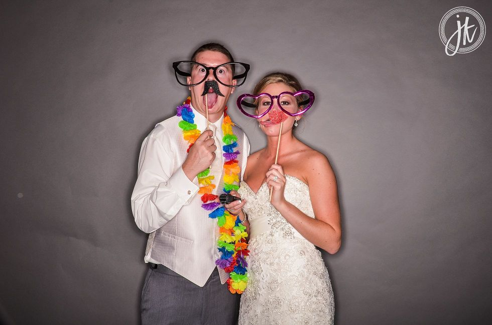 Bride and groom with silly props at Jeff City MO Wedding Reception